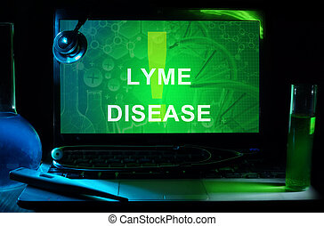Lyme Disease - Notebook with words Lyme Disease, test tubes...