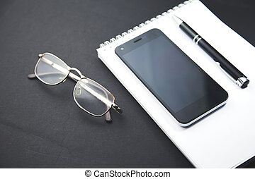 notebook,pen,paper,glasses and  phone