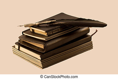 Notebooks - A pile of notebooks with a black old pen