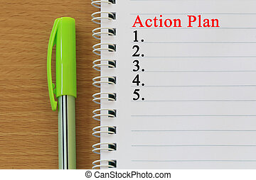 Notebooks and action plan text are placed on a brown wooden floor.