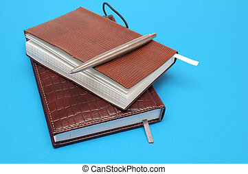 Notebooks on blue background
