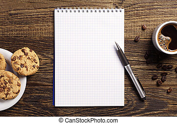 Notepad and coffee with cookies - Opened notepad and cup of...