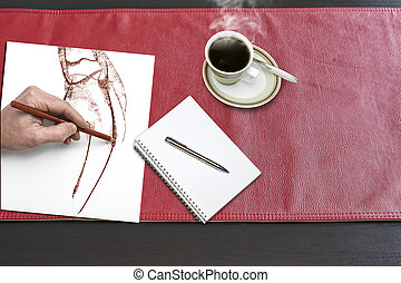 Notepad and hand drawing on Red leather tablecloth