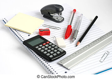 notepad calculator ruler pens pencil stapler