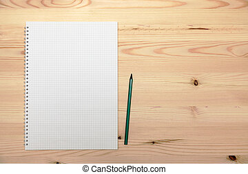 Notepad (copybook) with spiral and pencil on light wooden table, top view