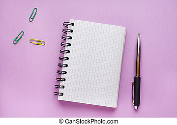 Notepad for text on pink table with copy space. Education and office concept