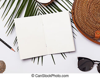 Notepad mock-up on the table with summer accessories