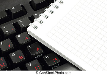 Notepad on a computer keyboard close-up