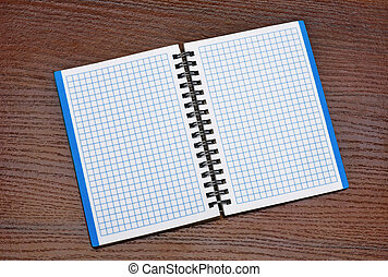 Notepad on a wooden table - Open notepad lay on a wooden...