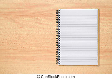 Notepad on office desk top view