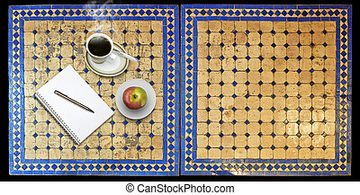 Notepad on Two moroccan mosaic table