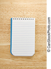 Notepad. - Open spiral bound notepad.
