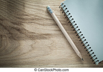 Notepad pencil on wooden board office concept