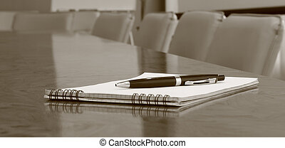 Notepad - Closeup of notepad on table in empty conference...