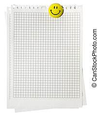 Notepad plaid pages with yellow smiling magnet isolated on...