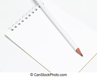 Notepad - sharp white pencil on the notepad
