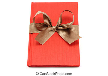 Notepad with brown bow on a white background