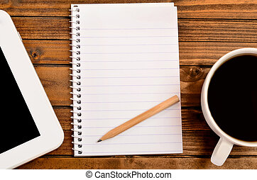 Notepad with coffee and tablet