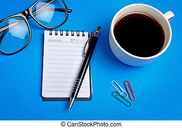 Notepad with coffee cup