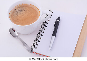 Notepad with cup of coffee.