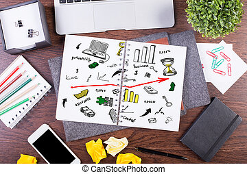 Notepad with drawn business icons