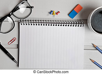 Notepad with office supplies