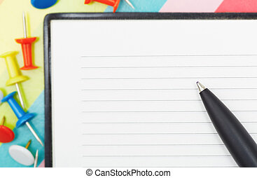 Notepad with pen and pushpins