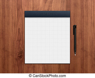 Blank notepad with pen on a wooden desk. High quality graphic collage.