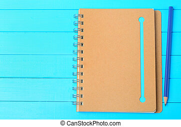 Notepad with pencil on table