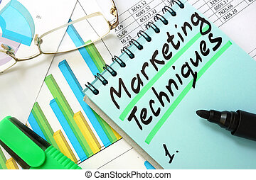 marketing techniques - Notepad with sign marketing...