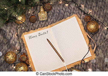 Notepad with the inscription dear santa on a gray knitted background