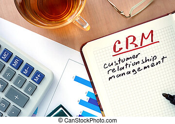 CRM customer relationship managemen - Notepad with word CRM...