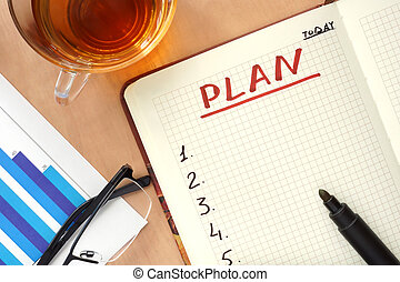 Notepad with word plan.