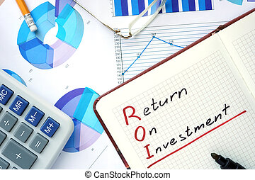 ROI return on investment - Notepad with word ROI return on...