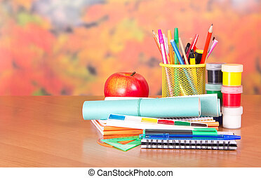 Notepad, writing materials and paints