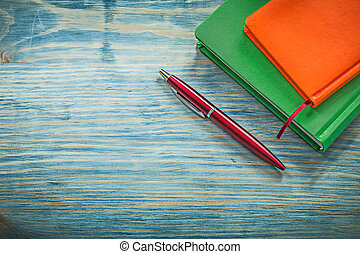 Notepads biro on wooden board education concept
