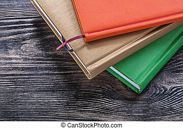 Notepads on vintage wooden board education concept
