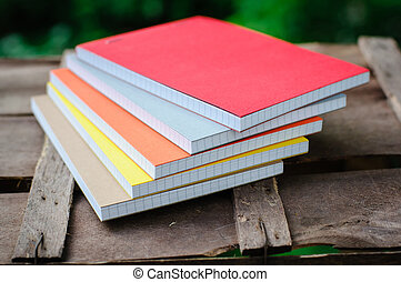 notepads on wood table