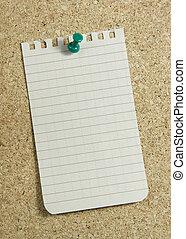 notepaper on corkboard