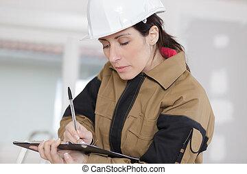 noteringen, arbetare, plats, konstruktion, kvinnlig, tagande