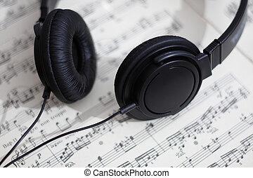 notes, écouteurs, noir