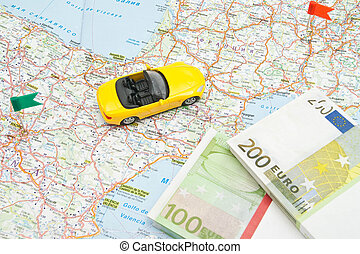 notes and yellow car on map