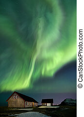 Nothern lights over the little houses of Iceland