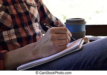 notizbuch, junger mann, schreibende