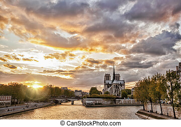 Notre Dame cathedral against sunset in Paris, France