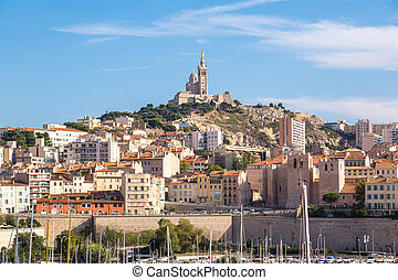 Notre Dame de la Garde and olf port in Marseille, France - ...