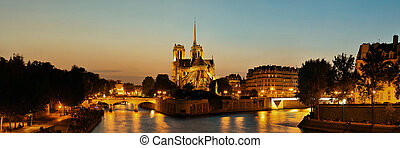 Notre Dame de Paris at dusk panorama over River Seine as the...