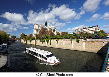 Notre Dame in Paris, France - Notre Dame with boat on Seine...