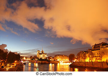 Notre Dame in Paris, France - Notre Dame with boats on Seine...