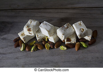 Nougat on a Table with Almonds and Pistachios